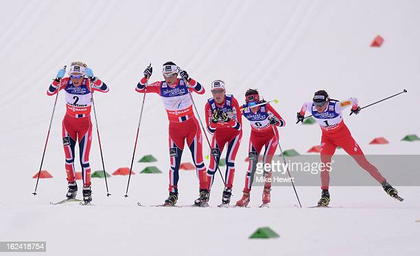 Therese Johaug of Norway competes with Marit Bjoergen of Norway and Justyna Kowalczyk of Poland during the Women's Skiathlon 75km at the FIS Nordic...