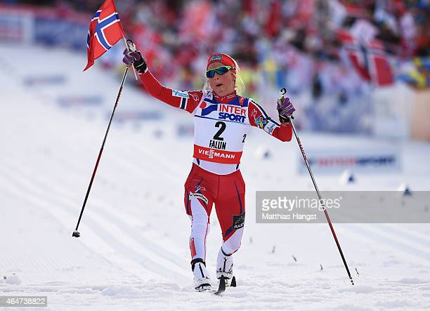 Therese Johaug of Norway crosses the finish line to win the gold medal in the Women's 30km Mass Start CrossCountry during the FIS Nordic World Ski...