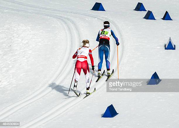 Therese Johaug of Norway Kerttu Niskanen of Finland competes during the Ladies 4 x 50 km Relay Classic/Free during the FIS Nordic World Ski...