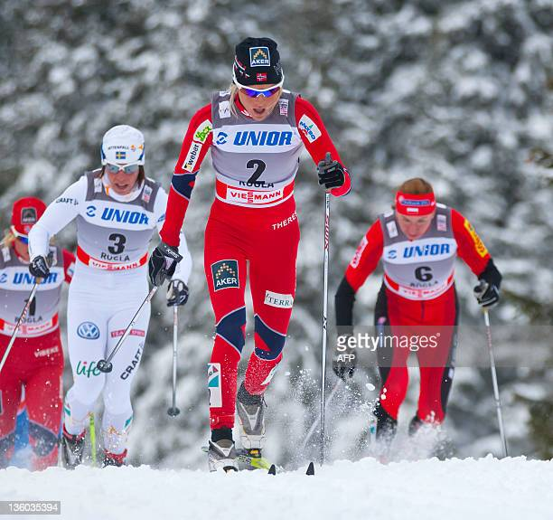 Therese Johaug of Norway leads the pack during the women's 10 km freestyle at the FIS ski crosscountry World Cup in Rogla on December 17 2011...