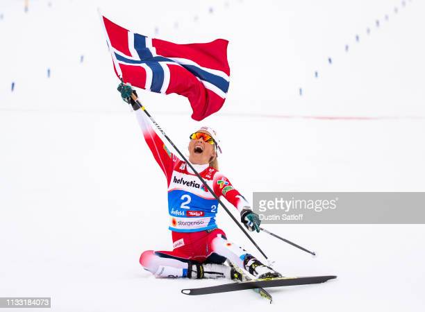 Therese Johaug of Norway reacts after she crosses the finish line finishing in first place in the Women's 30km Cross Country mass start during the...