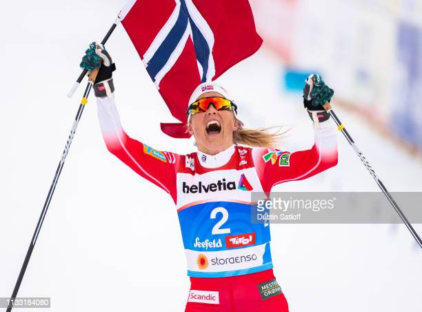 Therese Johaug of Norway reacts as she crosses the finish line finishing in first place in the Women's 30km Cross Country mass start during the FIS...