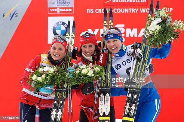 Therese Johaug of Norway second place Marit Bjoergen of Norway first place and Kerttu Niskanen of Finland third place during the FIS CrossCountry...