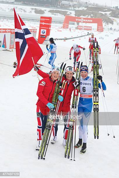 Therese Johaug of Norway second place Marit Bjoergen of Norway first place and Kerttu Niskanen of Finland third place pose for a photograph during...