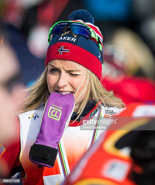 Therese Johaug of Norway seen after the race with her personal branded mittens during the FIS World Cup Lady 30 km Mass Start Free on March 15 2015...