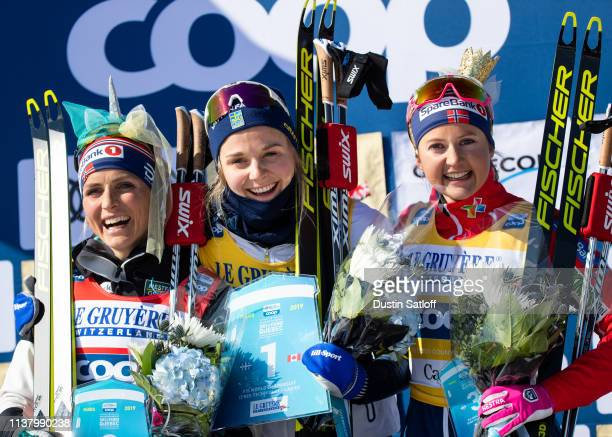 Therese Johaug of Norway, Stina Nilsson of Sweden, and Ingvild Flugstad Oestberg of Norway on the podium after the Women's 10km freestyle pursuit...