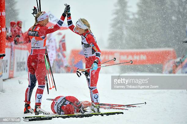 Therese Johaug of Norway takes 1st place Astrid Uhrenholdt Jacobsen of Norway takes 2nd place and Heidi Weng of Norway takes 3rd place during the FIS...