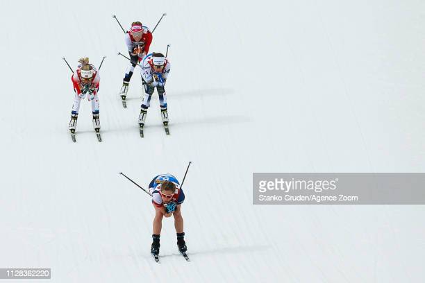 Therese Johaug of Norway takes 1st place Frida Karlsson takes 3rd place during the FIS Nordic World Ski Championships Women's Cross Country Mass...