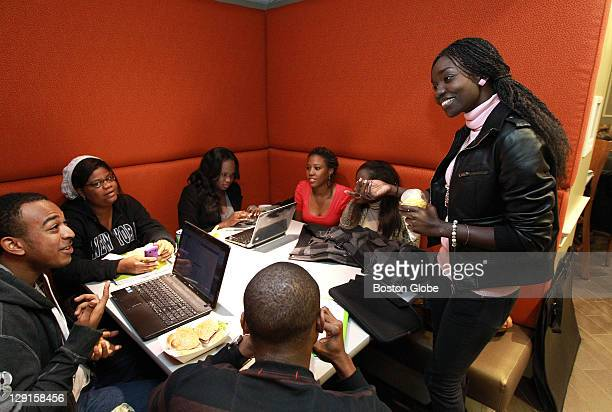 Therese L Mbaye of Senegal at far right and other students who attended Suffolk University's closed branch campus in Dakar during lunch at the...