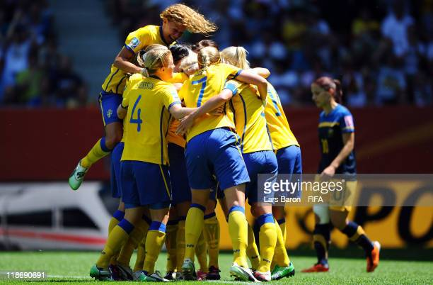 Therese Sjogran of Sweden celebrates with team mates after scoring his teams first goal during the FIFA Women's World Cup 2011 Quarter Final match...