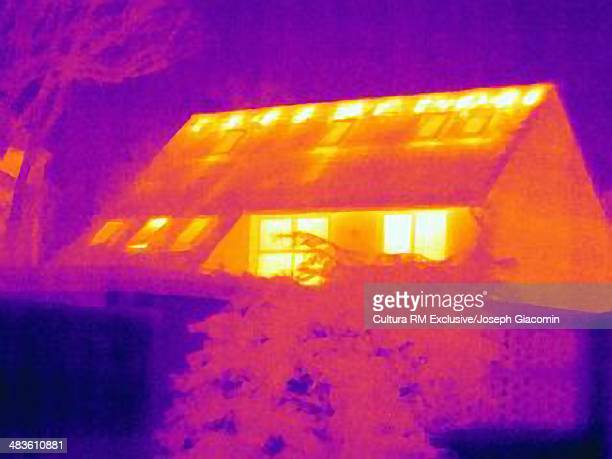 Thermal image of house, showing loss of heat from poor loft insulation