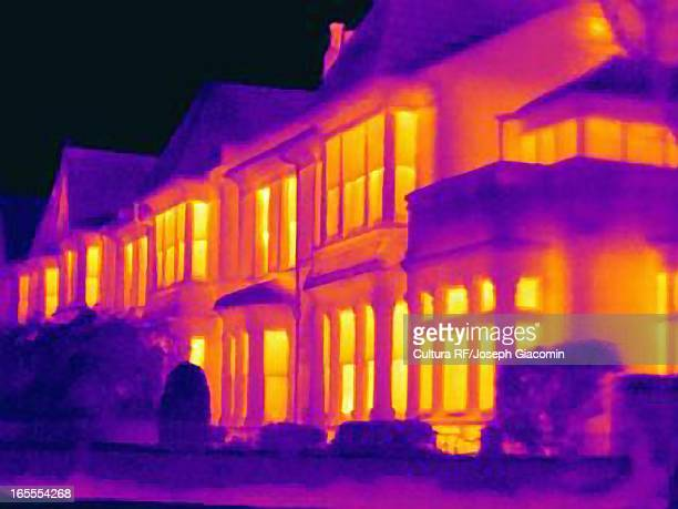 thermal image of houses on city street - infrarosso foto e immagini stock