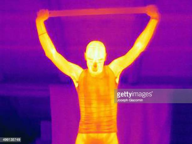 Thermal image of male athlete training with a metal bar