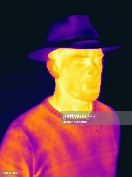 Thermal image of man wearing face mask panama hat