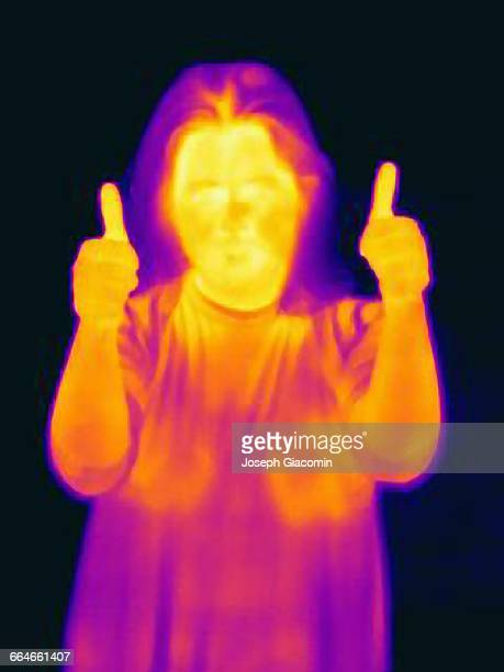Thermal image of woman holding hands in thumbs up
