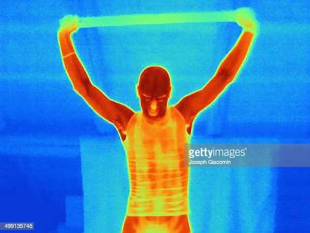 Thermal image of young male athlete training with a metal bar