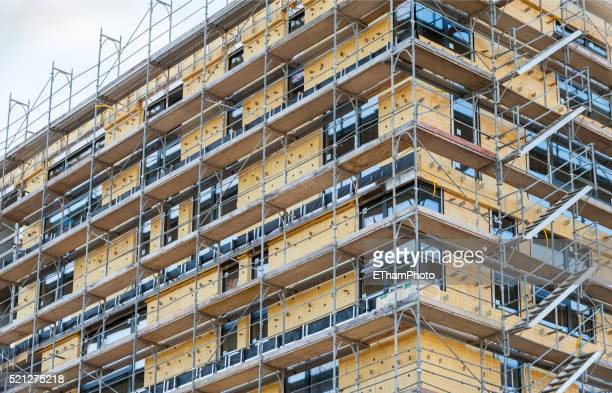 thermal insulation on building facade - facade stock pictures, royalty-free photos & images