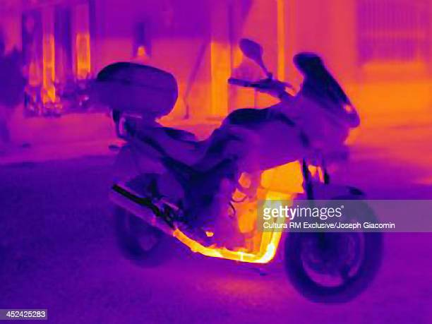 Thermal photograph of motorcycle showing heat of engine, radiator and exhaust pipe