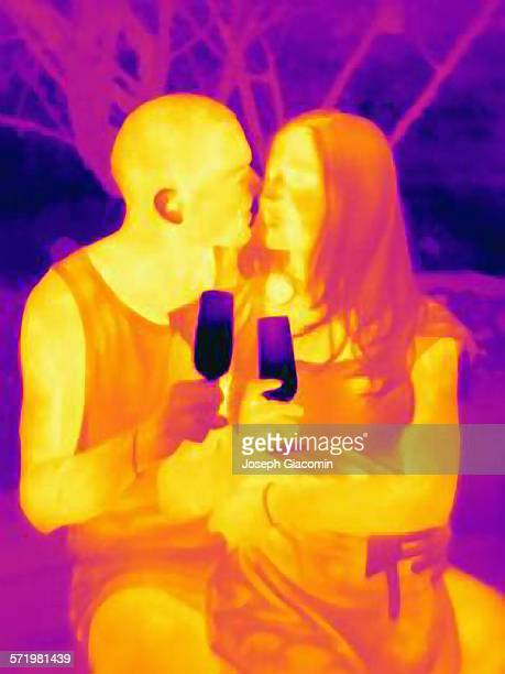 Thermal photograph of romantic young couple drinking wine