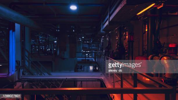 thermal power plant  in red light at night - district heating plant stock pictures, royalty-free photos & images