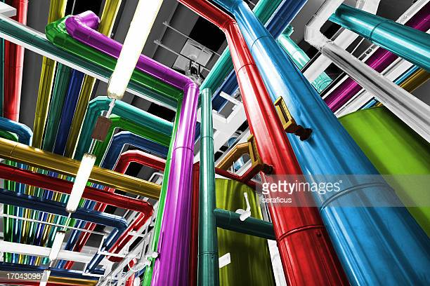 thermal power plant with its pipes brightly colored - red tube stock pictures, royalty-free photos & images