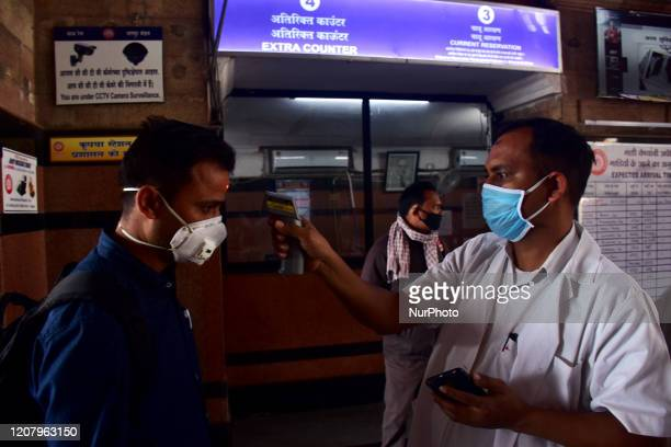 Thermal screening being conducted on passengers in Nagpur Railway station. One day nationwide Janata curfew imposed as a preventive measure against...