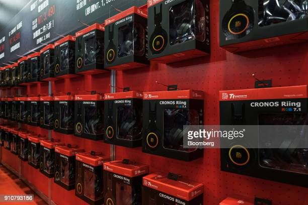 Thermaltake Technology Co TteSports Cronos Riing RGB 71 gaming headsets hang on display during the 2018 Taipei Game Show in Taipei Taiwan on Friday...