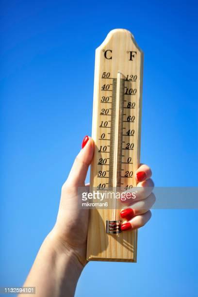 thermometer against a bright blue sky - värmebölja bildbanksfoton och bilder