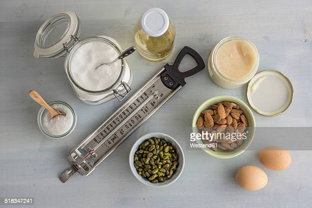 Thermometer and ingredients for making turron, elevated view