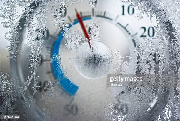 thermometer behind the frozen window - winter weather stock photos and pictures