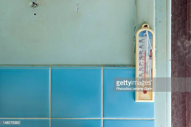 Thermometer hanging on wall