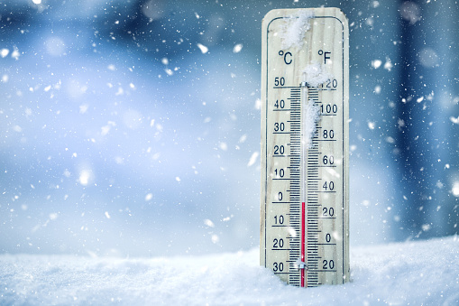 Thermometer on snow shows low temperatures - zero. Low temperatures in degrees Celsius and fahrenheit. Cold winter weather - zero celsius thirty two farenheit 868098786