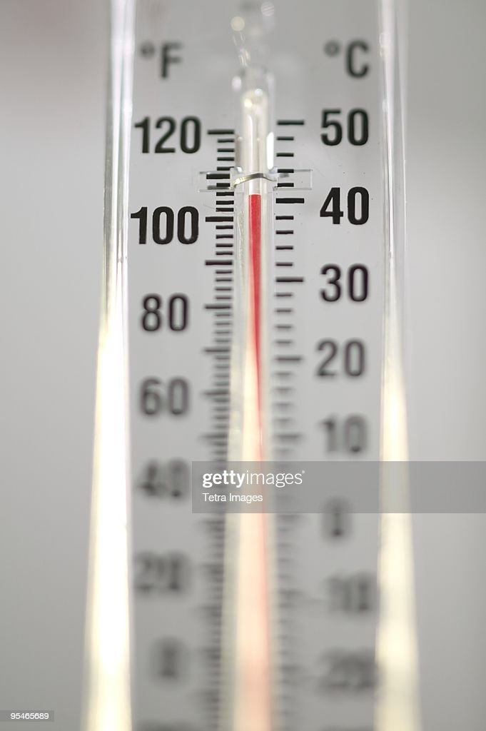 A Thermometer Reading 40 Degrees Celsius And 104 Fahrenheit Stock Photo
