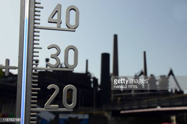 Thermometer show the temperature of over 40 degrees at the Volklingen Ironworks in Volklingen, western Germany on July 24, 2019. - Weather...