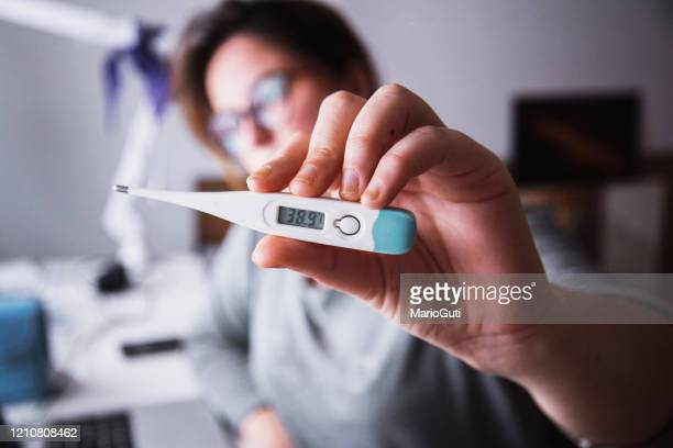 thermometer showing high fever - hot spanish women stock pictures, royalty-free photos & images