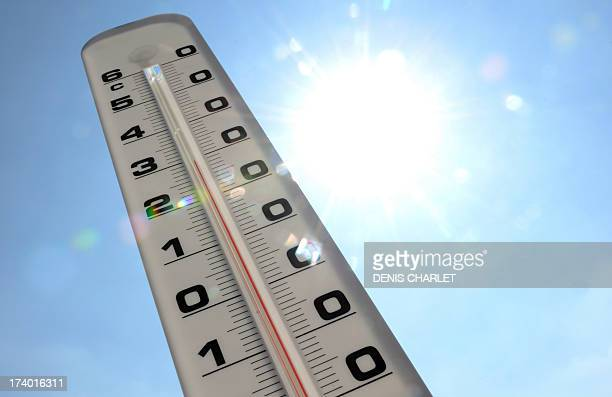 A thermometer shows the temperature rising up to 30 degrees Celcius on a warm sunny day on July 19 2013 in Lille northern France AFP PHOTO / DENIS...