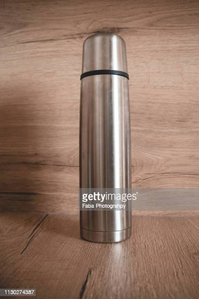 Thermos On Wooden Background