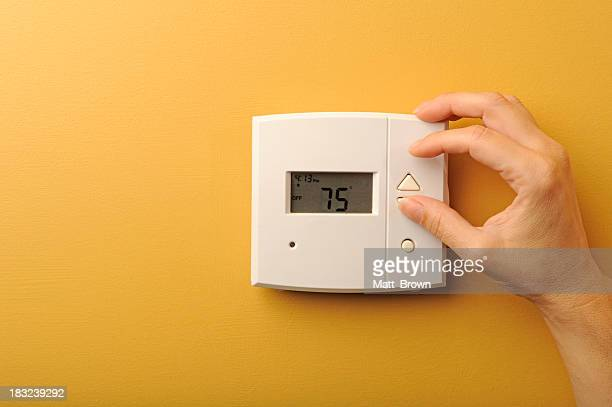 thermostat - adjusting stock pictures, royalty-free photos & images
