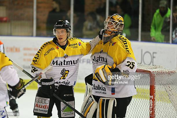 Thero Konttinen and Dany Sabourin of Rouen during the Ice hockey Ligue Magnus Final second game between Les Ducs d'Angers v Les Dragons de Rouen on...