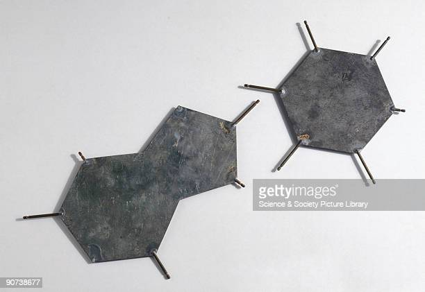 These aluminium templates are part of a model representing the structure of DNA. The plates represent bases, those groups of atoms that make up DNA's...