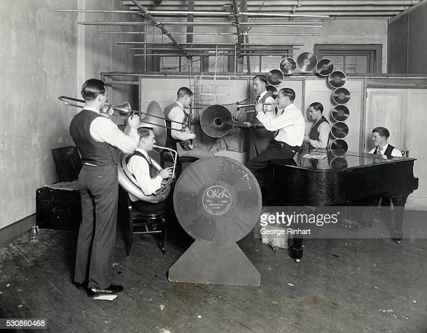These ambitious young men are playing to a large future audience at the parlors of the Consolidated Talking Machine company in Chicago where they are...
