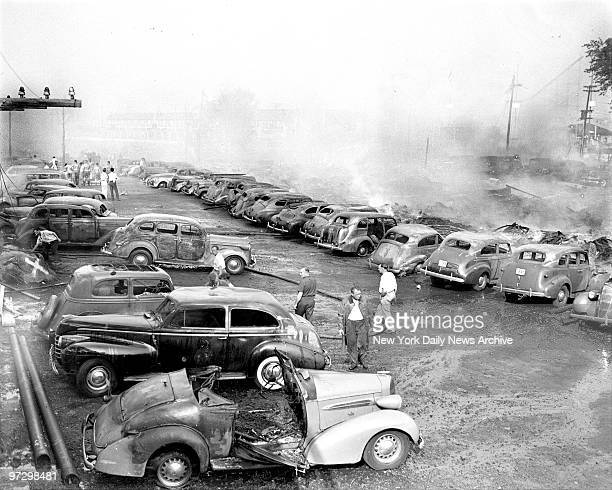 These are some of 200 cars going up in smoke that swept Palisades Amusement Park NJ opposite 125th St Manhattan Tougher still one jalopy burned up...