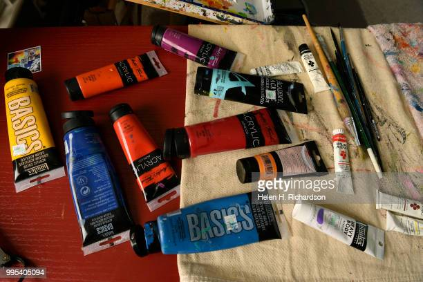 These are some of the bright acrylic paint that artist Tif Choate uses to paint in her home studio on July 1 2018 in Lafayette Colorado The smallest...