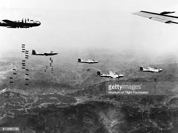 These Boeing B29 bombers of the 19th BG drop their loads of bombs over Iwo Jima in the Pacific during World War II in May of 1945