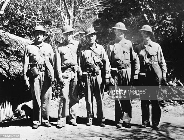 These five officers pictured against a jungle background have been fighting alongside Army and Navy forces on the Philippines Battle front and are...