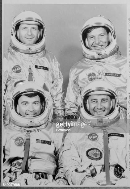 These four men form the crews for the first Gemini space flight scheduled for late 1964 or early 1965 Shown here in their space suits are front left...