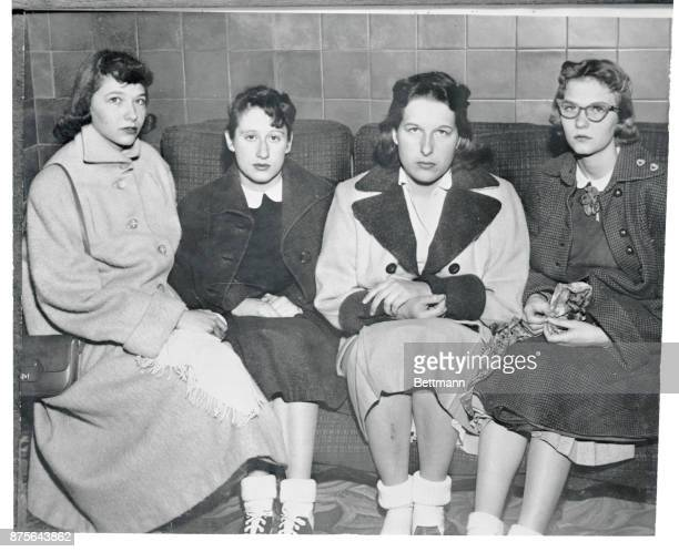 These four Newton Iowa high school girls in their late teens sit rather gloomily here after allegedly admitting to authorities that their story of...