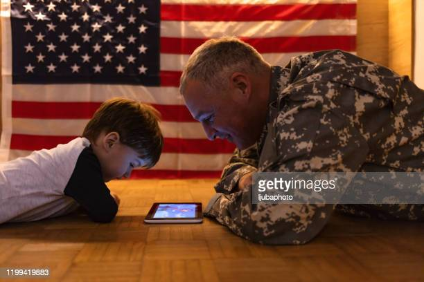 these gadgets are so handy, even for story time! - family politics stock pictures, royalty-free photos & images