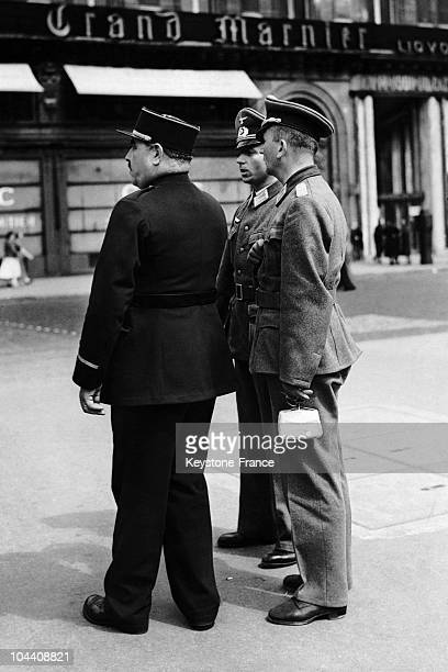 These Germany army officers are asking a French policeman for directions