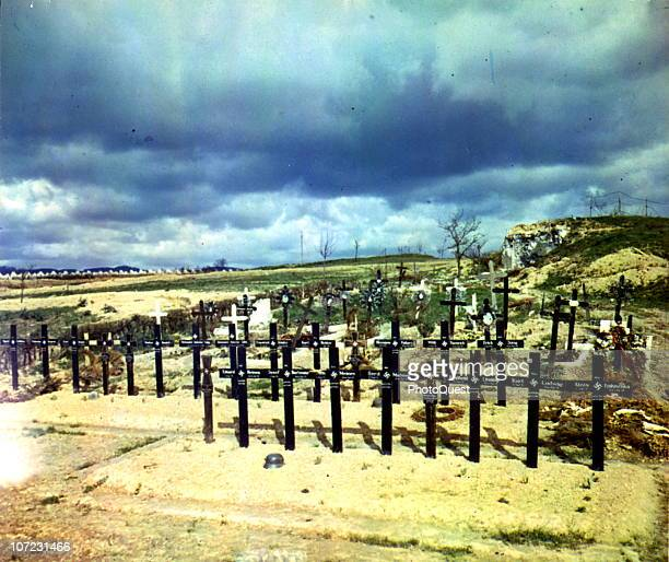 These graves mark the bodies of German soldiers killed defending the Siegfried LIne fortifications in the background Germany 1945